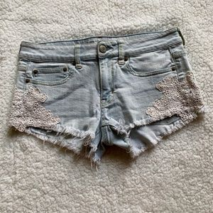 AE stretch distressed denim shorts with lace